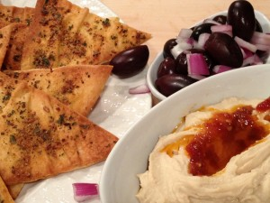pita chips with humus and Boukovo chili oil