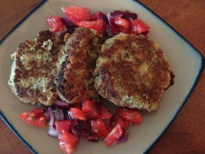 chickpea fritters with red onions a chopped tomatoes
